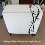 old 1960's leaf table has been painted white white with black curvy line and concentric circle design and black legs