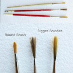 photo of a round head brush and two rigger brushes use to paint teh design on the leaf table