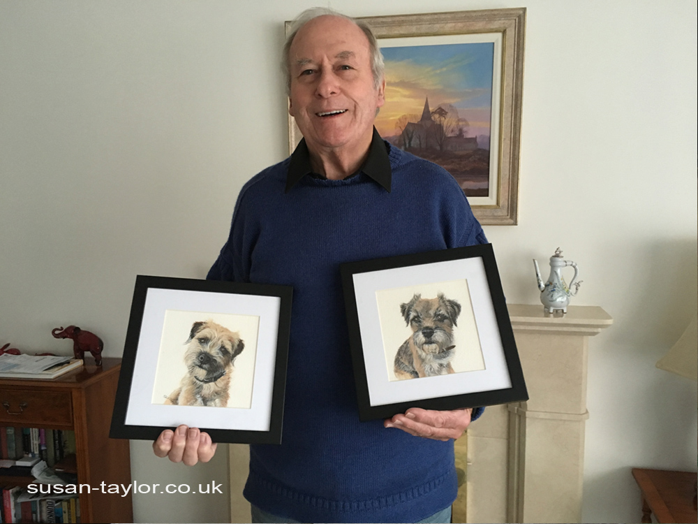 a happy client holding his freshly painted and framed watercolor pet portraits by artist Susan Taylor